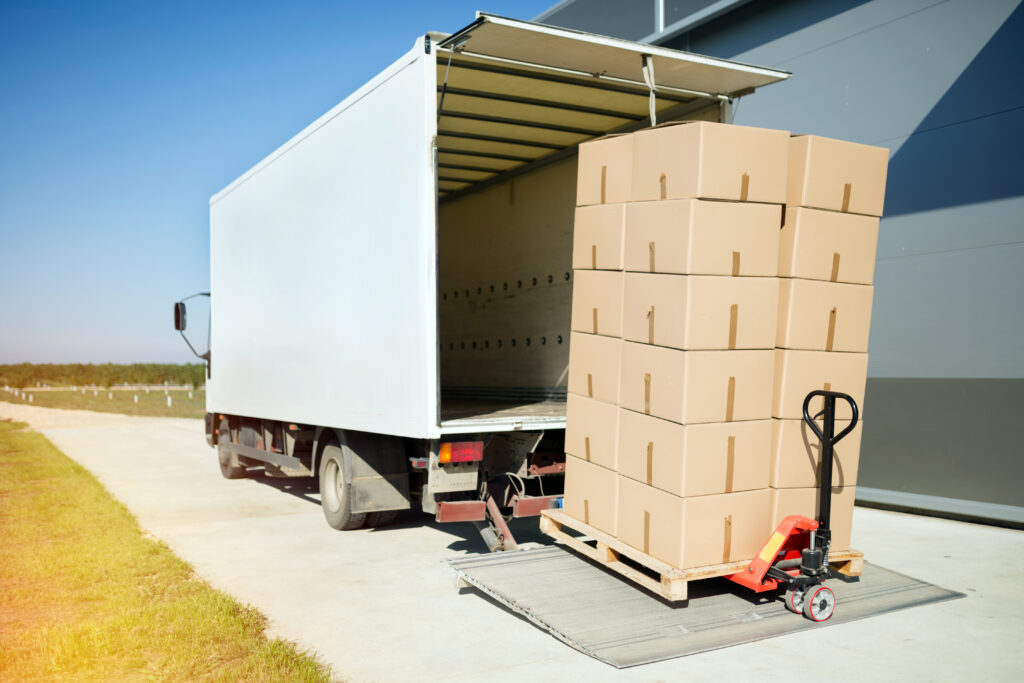 Truck transporting goods packed in boxes from warehouse