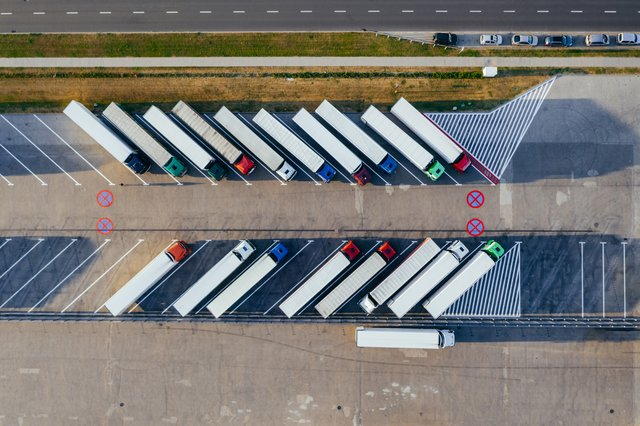 aerial view of colorful freight trucks in a parking lot