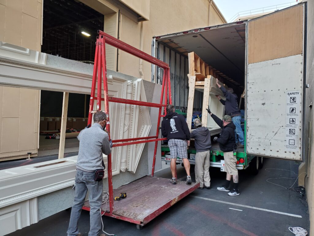 pyramid logistics team moving a film industry set from truck